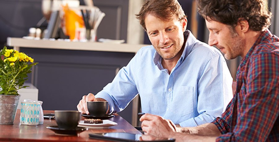 Two Men Discussing Their Pension Over Coffee