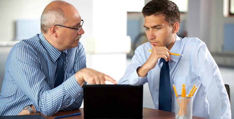 Financial Adviser Speaking About Drawdown To An Elder Gentlemen